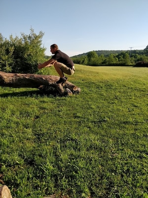 Dan Roberts demonstrates a jump used as part of the 8-week virtual fitness challenge.