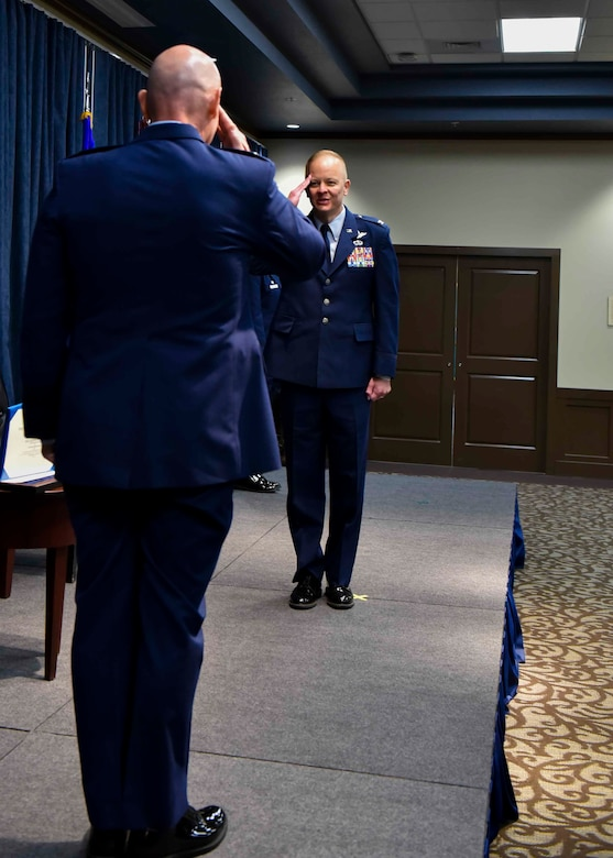 U.S. Air Force Col. Derek Salmi, outgoing 92nd Air Refueling Wing commander, salutes Maj. Gen. Sam Barrett, 18th Air Force commander, during the 92nd ARW change of command ceremony