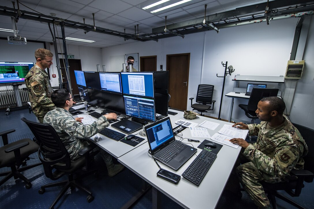 Photo of Airmen using computer