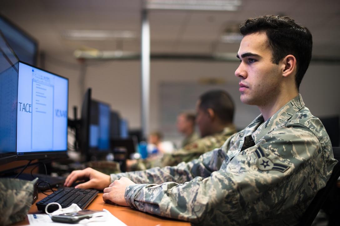 Photo of Airman using computer