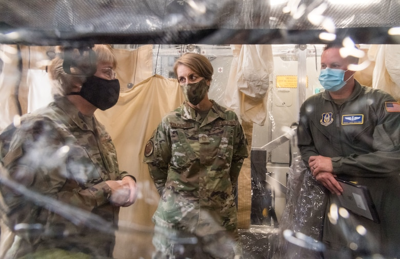 From the left, Lt. Gen. Dorothy Hogg, U.S. Air Force surgeon general, and Chief Master Sgt. Dawn Kolczynski, AF/SG chief of medical operations, talk with Senior Master Sgt. Michael Malone, 36th Aeromedical Evacuation Squadron training noncommissioned officer in charge and AE technician, from Keesler Air Force Base, Mississippi, inside a Transport Isolation System, June 26, 2020, at Dover Air Force Base, Delaware. Dover serves as the U.S. East Coast hub for the TIS. (U.S. Air Force photo by Roland Balik)