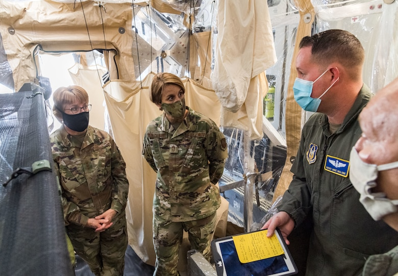 From the left, Lt. Gen. Dorothy Hogg, U.S. Air Force surgeon general, and Chief Master Sgt. Dawn Kolczynski, AF/SG chief of medical operations, talk with Senior Master Sgt. Michael Malone, 36th Aeromedical Evacuation Squadron training noncommissioned officer in charge and AE technician, and Maj. Mark Dellinger, 36th AES training flight commander, both from Keesler Air Force Base, Mississippi, inside a Transport Isolation System, June 26, 2020, at Dover Air Force Base, Delaware. Dover serves as the U.S. East Coast hub for the TIS. (U.S. Air Force photo by Roland Balik)