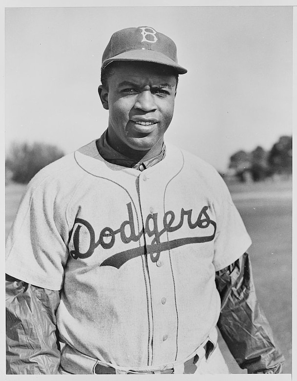 Baseball great Jackie Robinson poses for a photo.