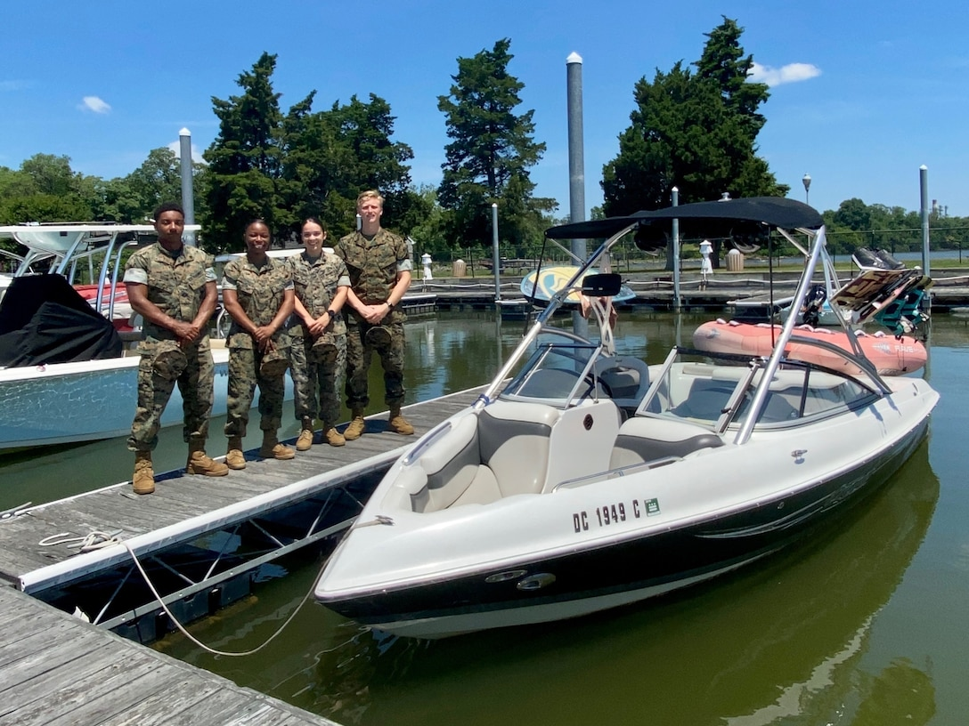 U.S. Marines stand in front of the boat they used to help rescue a father and son on the Potomac River in Nanjemoy, Maryland, June 14.