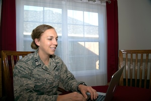 U.S. Air Force Reservist Capt. Erin Rost, United States Air Force Academy admissions liaison officer, conducts an interview with a prospective academy student while teleworking from home during the COVID-19 pandemic May 7, 2020, at Shaw Air Force Base, South Carolina.