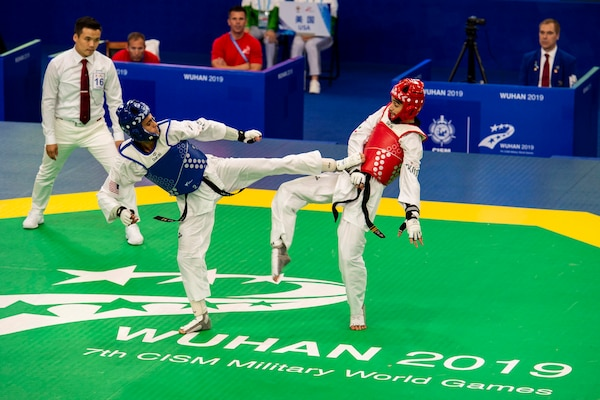 Army Pvt. 2nd Class Juan Carlos Norzagaray-Garcia with the U.S. Armed Forces Taekwondo Team fights Iran's Mahaleh Kalaei Iman at the CISM Military World Games in Wuhan, China, Oct. 26, 2019.  (DoD photo by Mass Communication Specialist 1st Class Ian Carver)