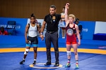 SSgt. Whitney Conder with the U.S. Armed Forces Wrestling Team is announced as the victor in her match against Egypt in the 50 kg. weight class at the Council of International Sports for Military games (CISM) in Wuhan, China Oct. 22, 2019. The CISM games opened Oct. 18, 2019 and close Oct. 28, 2019. (DoD photo by Mass Communication Specialist 1st Class Ian Carver/RELEASED)