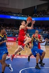 U.S. Navy Lt. Junior Grade Grant Vermeer, U.S Armed Forces Men's Basketball Team member, soars past a competitor for a layup during the 7th Conseil International du Sport Militaire World Games in Wuhan, China Oct. 25, 2019. The U.S. team defeated Brazil 78-61 to advance to the gold medal game against the Lithuania. (U.S. DoD photo by Staff Sgt. Vito T. Bryant)