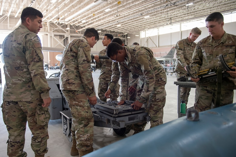 Airmen learn to disassemble and inspect a missile loading adapter