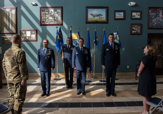 Maj. Gen. Chad P. Franks, Ninth Air Force commander (left), Col. Donn C. Yates, 4th Fighter Wing outgoing commander (center), and Col. Kurt C. Helphinstine, incoming 4 FW commander (right), listen as the 4 FW change of command ceremony citation is read at Seymour Johnson Air Force Base, North Carolina, July 2, 2020. The 4 FW change of command ceremony highlighted the 28-year military career of Yates, and honorably welcomed Helphinstine as the new 4 FW commander, before family, wing leadership and Team Seymour. (U.S. Air Force photo by Senior Airman Kenneth Boyton)