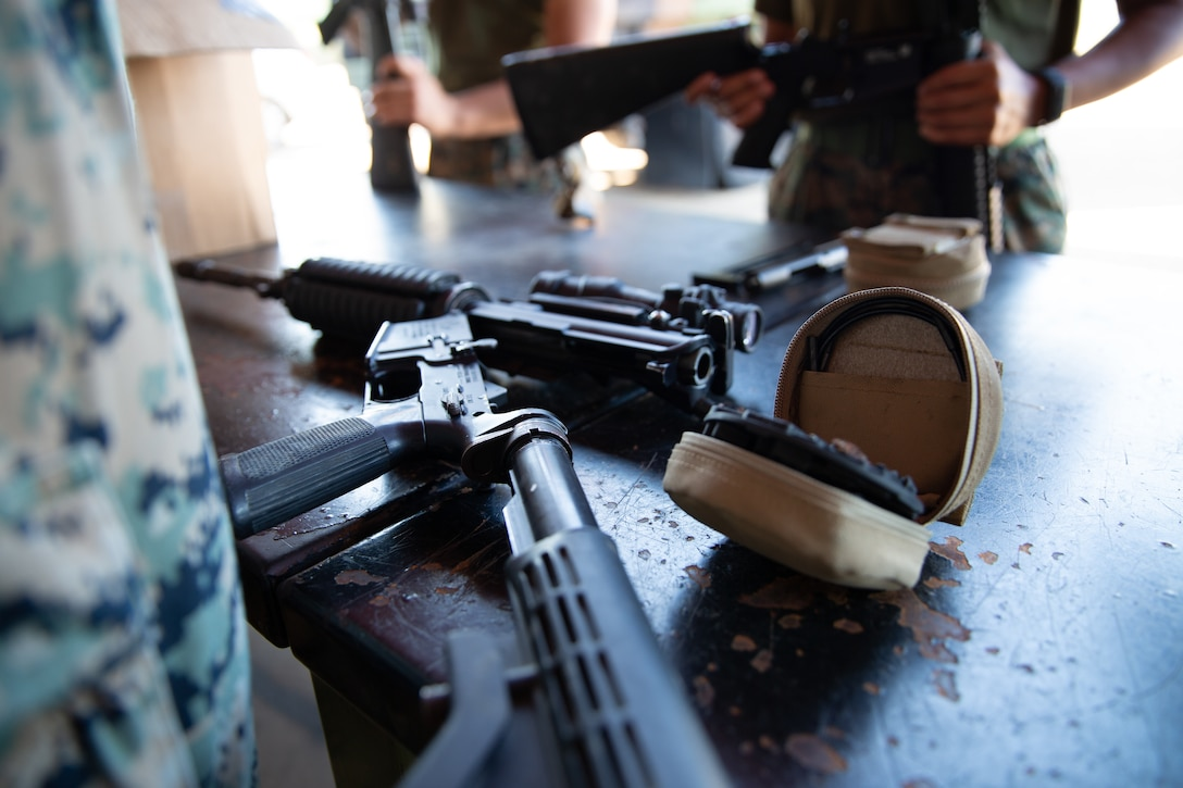 U.S. Marines with Marine Rotational Force - Darwin, clean weapons on Robertson Barracks, NT, Australia, June 30.