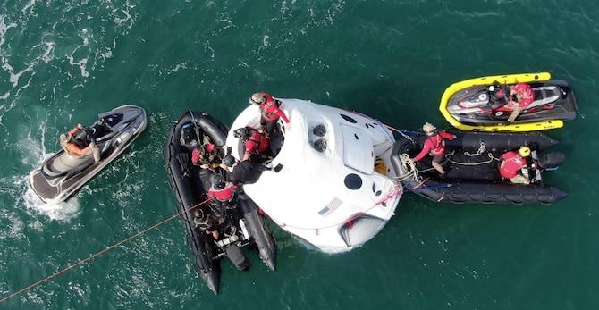 Airmen execute open water rescue training.