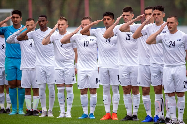 U.S. Armed Forces Men's Soccer Team members salute at the start of a preliminary round match with Qatar for the CISM 2019 Military World Games in Wuhan, China Oct. 16, 2019. The Council of International Sports for the Military games open Oct. 18, 2019 and close Oct. 28, 2019. (DoD photo by EJ Hersom)