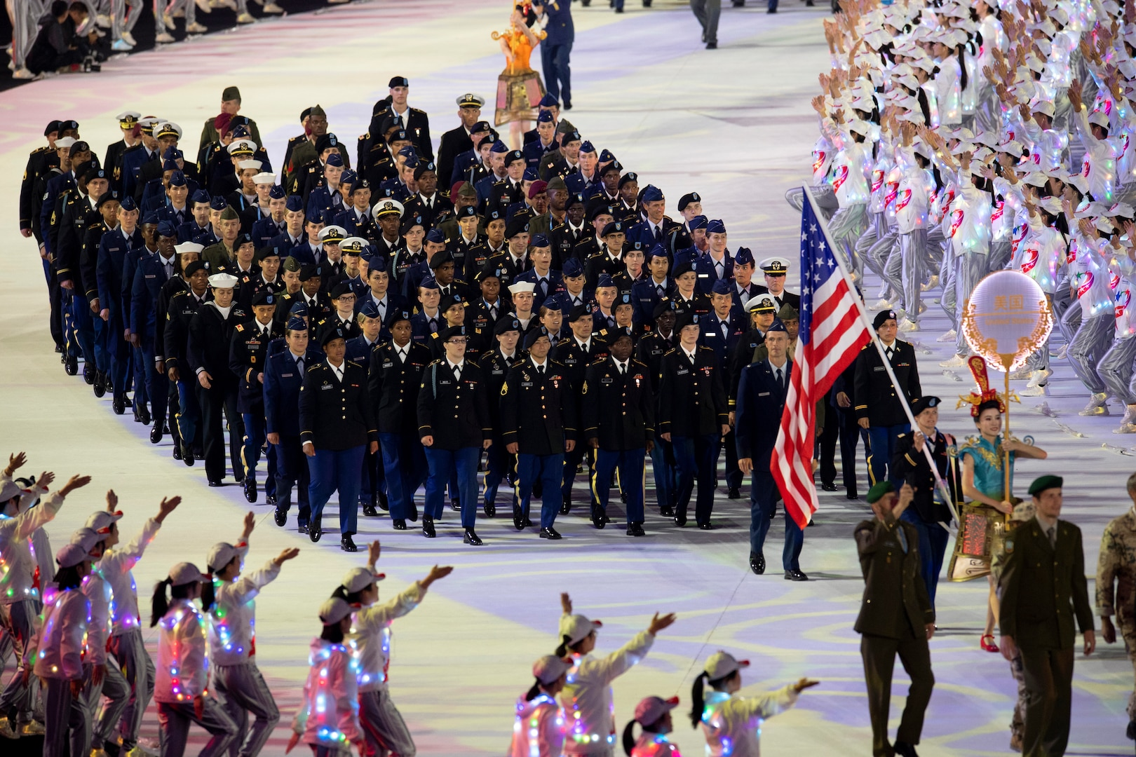 The U.S. Armed Forces Sports team marches during opening ceremonies for the 2019 CISM Military World Games in Wuhan, China Oct. 18, 2019. Teams from more than 100 countries will compete in dozens of sporting events through Oct. 28. (DoD photo by EJ Hersom)