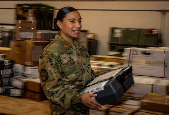 Airman carrying package