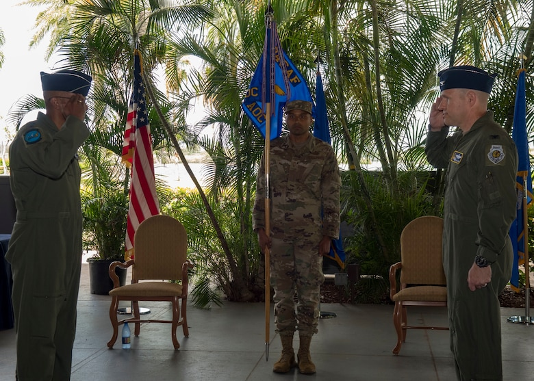Col. Nicholas Evans, 613th Air Operations Center commander, salutes Gen. CQ Brown, Jr., Pacific Air Forces commander, during the 613th AOC change of command ceremony, Joint Base Pearl Harbor-Hickam, Hawaii, June 29, 2020. Evans most recently served as the commander of the 8th Operations Group, Kunsan Air Base, Republic of Korea. (U.S. Air Force photo by Staff Sgt. Mikaley Kline)