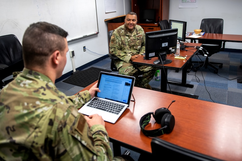 U.S. Air Force Tech. Sgt. Kurt Alie (right), Robert D. Gaylor Non-Commissioned Officer Academy student instructor, receives an evaluation from Tech. Sgt. Michael Napieraj, instructor trainer, while Tech. Sgt. Alie's virtual class takes a break June 23, 2020, at Joint Base San Antonio-Lackland, Texas.