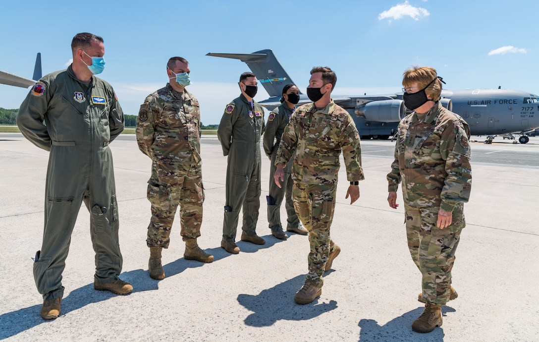 Capt. Travis Parrot, 3rd Airlifter Squadron pilot and stage representative, escorts Lt. Gen. Dorothy Hogg, U.S. Air Force surgeon general, onto a C-17 Globemaster III, June 26, 2020, at Dover Air Force Base, Delaware. Hogg was briefed on the Transport Isolation System and met with 10th Expeditionary Aeromedical Evacuation Flight aircrew, the TIS support team and 736th Aircraft Maintenance Squadron personnel. (U.S. Air Force photo by Roland Balik)