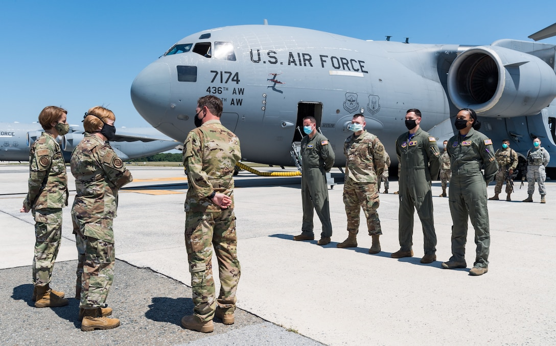 Capt. Travis Parrot, 3rd Airlift Squadron pilot and stage representative, talks with Lt. Gen. Dorothy Hogg, U.S. Air Force surgeon general, and Chief Master Sgt. Dawn Kolczynski, AF/SG chief of medical operations, in front of a C-17 Globemaster III, June 26, 2020, at Dover Air Force Base, Delaware. Hogg and Kolczynski were given a briefing on the Transport Isolation System and met with 10th Expeditionary Aeromedical Evacuation Flight aircrew, the TIS support team and 736th Aircraft Maintenance Squadron personnel. (U.S. Air Force photo by Roland Balik)