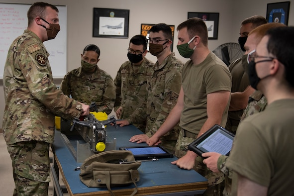 Airmen learn how to disassemble a MAU-12 bomb rack