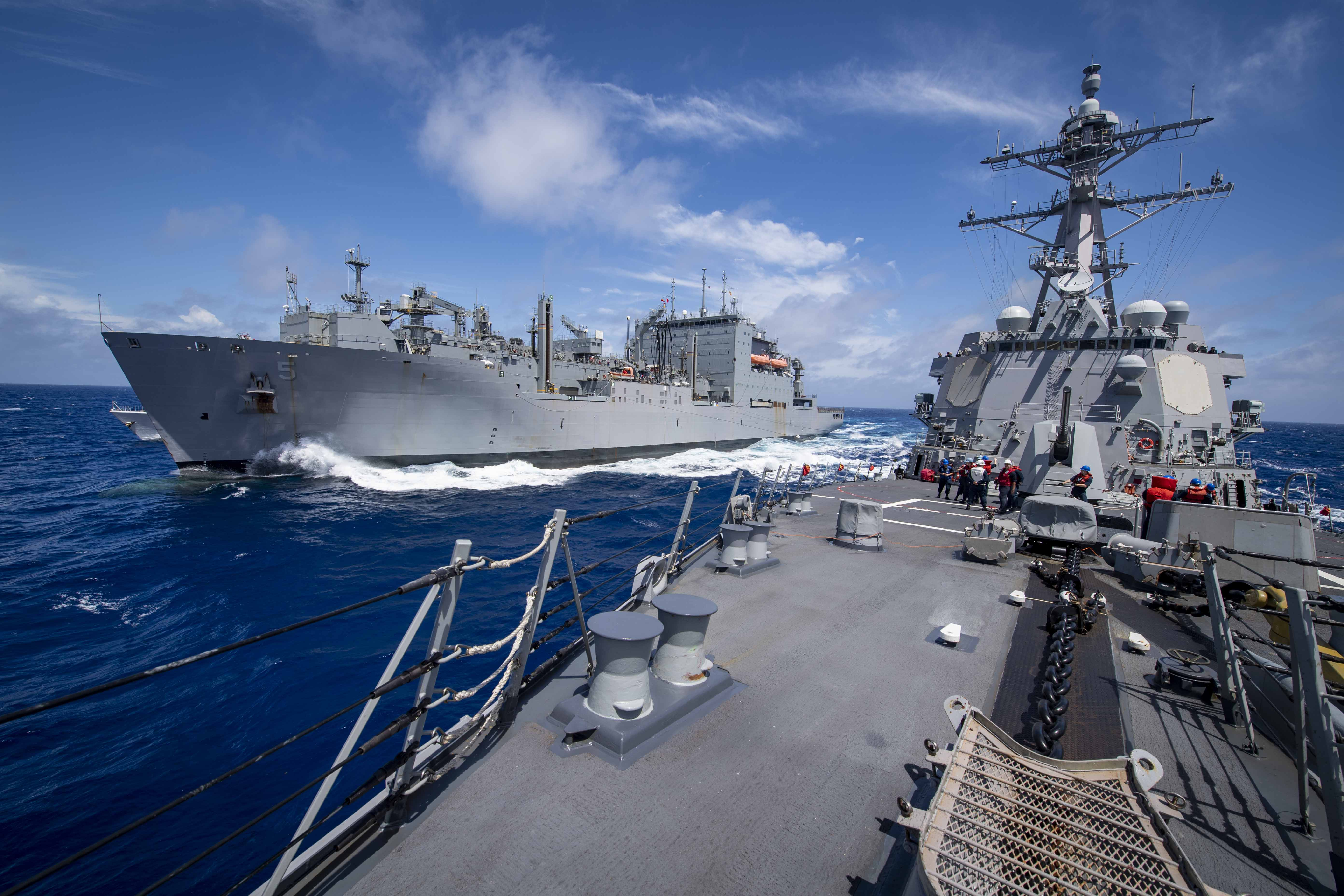 USS Gridley (DDG 101), right, steams alongside the Lewis and Clark-class dry cargo ship USNS Robert E. Peary (T-AKE 5) during a replenishment-at-sea.