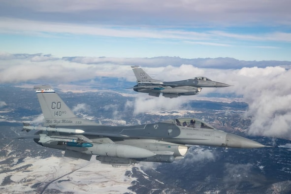Two F-16 Fighting Falcon aircraft from the 120th Fighter Squadron, Colorado Air National flyover the state of Colorado on an unspecified date. (stock photo)