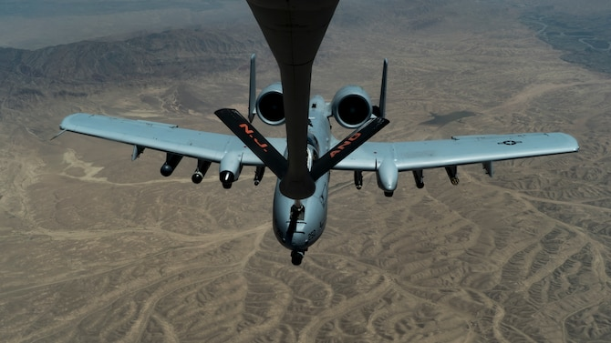 A U.S. Air Force A-10 Thunderbolt II receives fuel from a U.S. Air Force KC-135 Stratotanker assigned to the 340th Expeditionary Air Refueling Squadron over the U.S. Central Command area of responsibility, June 15, 2020. The 340th EARS, deployed with U.S. Air Forces Central Command, is responsible for delivering fuel to U.S. and coalition forces, enabling war-winning airpower, deterrence, and stability to the region. (U.S. Air Force photo by Senior Airman Brandon Cribelar)