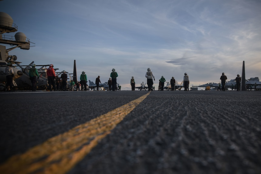 PHILIPPINE SEA (July 1, 2020) Sailors conduct a foreign object debris walkdown on the flight deck of the Navy's only forward-deployed aircraft carrier USS Ronald Reagan (CVN 76) maintaining Ronald Reagan's tactical presence on the seas. Ronald Reagan is the flagship of the Reagan Carrier Strike Group (CSG). The USS Nimitz (CVN 68) and Ronald Reagan CSGs are conducting dual-carrier operations in the Philippine Sea as the Nimitz Carrier Strike Force.
