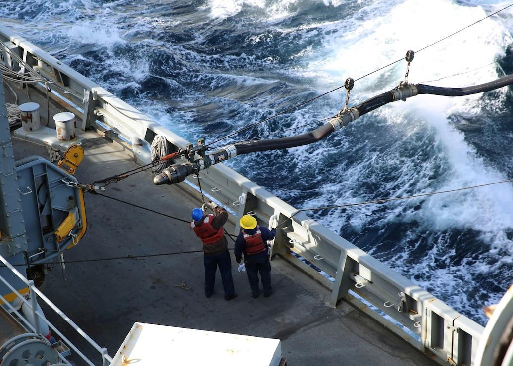 USNS Arctic recieves a fuel line from USNS Laramie