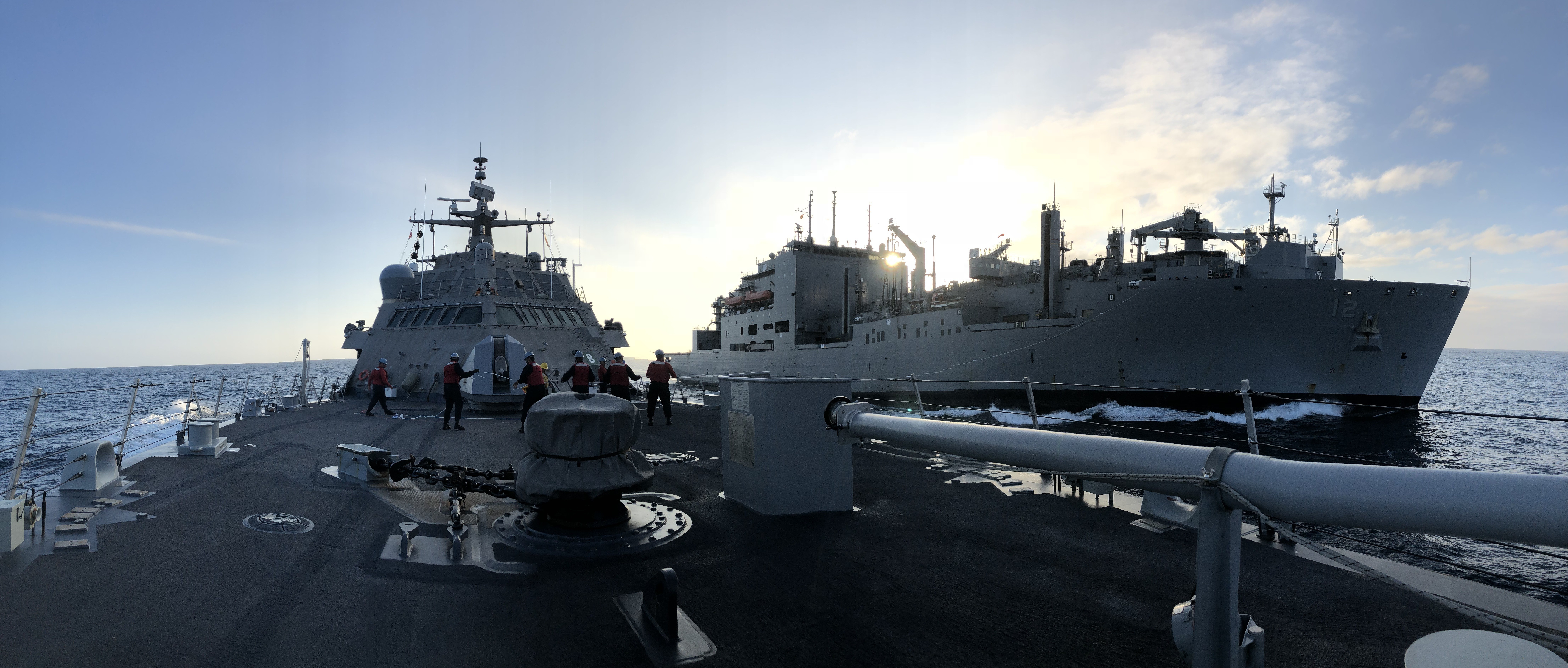Sailors aboard the Freedom-class littoral combat ship USS Detroit (LCS 7) conduct a replenishment-at-sea with the Lewis and Clark-class dry cargo and ammunition ship USNS William McLean (T-AKE 12).