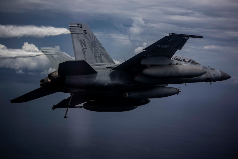 "An F/A-18 Super Hornet attached to the ""Diamondbacks"" of Strike Fighter Squadron (VFA) 102 conducts air operations while flying with aircraft from the Nimitz Carrier Strike Force. The USS Nimitz (CVN 68) and USS Ronald Reagan (CVN 76) Carrier Strike Groups are conducting dual-carrier operations in the South China Sea as the Nimitz Carrier Strike Force. (U.S. Navy photo by Lt. Cmdr. Joseph Stephens)"