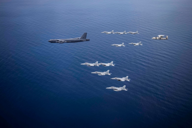 Aircraft from the Nimitz Carrier Strike Force and a B-52 Bomber from Barksdale Air Force base conduct integrated joint air operations in support of a free and open Indo-Pacific. The USS Nimitz (CVN 68) and USS Ronald Reagan (CVN 76) Carrier Strike Groups are conducting dual-carrier operations in the South China Sea as the Nimitz Carrier Strike Force. (U.S. Navy photo by Lt. Cmdr. Joseph Stephens)