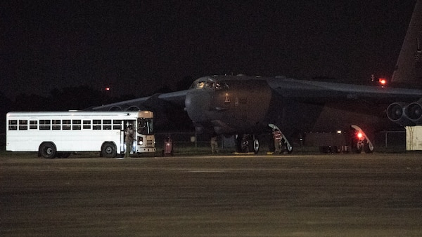 Barksdale aircrew exit a bus before taking off in a B-52H Stratofortress from Barksdale Air Force Base, La., in support of a U.S. Strategic Command Bomber Task Force, July 2, 2020. BTF missions familiarize aircrews with air bases, procedures and operations in different Geographic Combatant Command's areas of operations. (U.S. Air Force photo by Senior Airman Tessa B. Corrick)