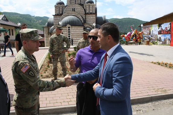 Lt Col Donald Braman, commander of 3rd Squadron, 61st Cavalry Regiment, 2nd Infantry Brigade Combat Team, 4th Infantry Division, meets Leposavic mayor Zoran Todic during the Saint Vasilije Ostroski Festival on 19 May 2018 in Leposavic, Kosovo. (Photo Credit: US Army)