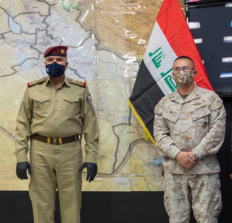 Iraqi Staff Lt. Gen. Abd al-Amir al-Shammari (left), deputy commander of the Joint Operations Command for Iraq (JOC-I), addresses attendees gathered for the change-of-command ceremony signifying Combined Joint Task Force-Operation Inherent Resolve's Task Force Iraq transition to the Military Advisory Group.