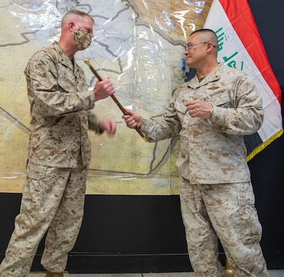 "U.S. Marine Brig. Gen. Bill Seely (right), the departing commander of Combined Joint Task Force-Operation Inherent Resolve's Task Force Iraq, passes the ceremonial ""swagger stick"" to U.S. Marine Brig. Gen. Ryan Rideout, incoming Military Advisory Group director, signifying the transition of Task Force Iraq into the Military Advisory Group."