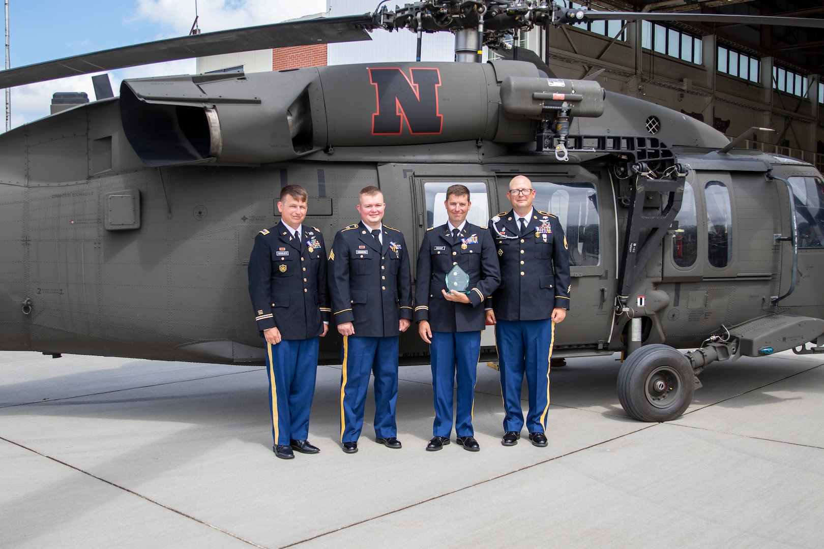From left, Chief Warrant Officer 2 Nathan Dooley, pilot; Sgt. Aaron Winberg, crew chief; Chief Warrant Officer 3 Josh Schaaf, pilot-in-command; and Staff Sgt. Lawrence Lind, combat medic, with the DUSTOFF 2019 Rescue of the Year award. Flying the Nebraska Army National Guard UH-60 Black Hawk helicopter behind them the evening of March 14, 2019,  they rescued seven first responders from floodwaters near the Elkhorn River.