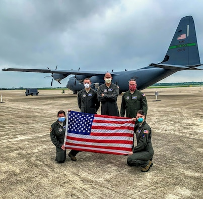 (Upper left) U.S. Air Force Staff Sgt. Timothy Congo, an aeromedical evacuation technician with the 439th Aeromedical Evacuation Squadron, poses for a photo with other 439th AES members April 11, 2020, at Kelly Airfield in Joint Base San Antonio-Lackland, Texas. Aeromedical evacuation members are responsible for providing patient medical care in-flight. (Courtesy photo)