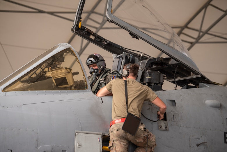A photo of an Airmen troubleshooting an aircraft maintenance issue.