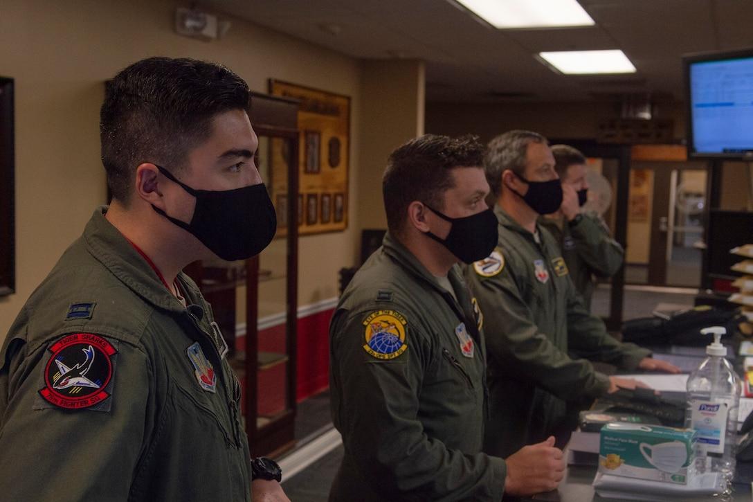 A photo of Airmen receiving a briefing