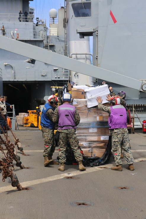 200702-M-CB805-1026 ATLANTIC OCEAN (July 2, 2020) Marines assigned to Combat Logistics Battalion 26, 26th Marine Expeditionary Unit (MEU), unpack supplies during a vertical replenishment-at-sea aboard the amphibious dock landing ship USS Oak Hill (LSD 51) July 2, 2020. 26th MEU is conducting operations in U.S. 6th Fleet in support of regional allies and partners, and U.S. national security interests in Europe and Africa.  (U.S. Marine Corps photo by Staff Sgt. Pablo D. Morrison/Released)