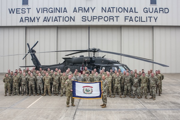 Members of the Charlie Company, 2nd General Support Battalion, 104th Aviation Regiment, (2-104th GASB) pose for a photo at the West Virginia National Guard Army Aviation Support Facility in WIlliamstown, W.Va. More than 60 service members, including pilots, maintainers, flight medics and support staff, will deploy to support aviation operations within the Middle East area of responsibility.