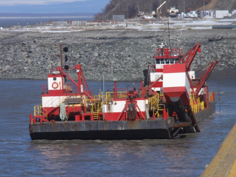 The Westport, a red and white hopper dredge operated by Manson Construction, dredges near the Port of Alaska on April 3, 2019.