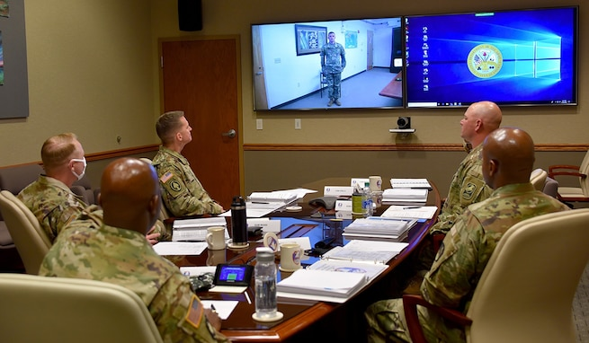 Staff Sgt. Taylor, a satellite network planner, with the Satellite Operations Brigade at Wheeler Army Air Field, Hawaii, U.S. Army Space and Missile Defense Command, virtually addresses the board of six command sergeants major at Peterson Air Force Base, Colorado, during the command's Best Warrior Competition June 30. (U.S. Army photo by Dottie K. White)