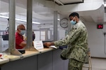 Code 1123 Security Assistant Walter Fung issues a pass to a visitor at Bldg. 207 Pass & ID. Code 1123 Industrial Security Branch is dedicated to providing quality professional service, while ensuring the safety and security of personnel and critical assets.