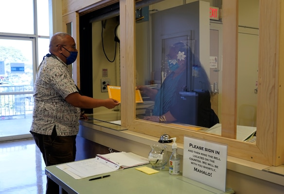 Code 1143 Mail and File Assistant Ryan Namaka passes a