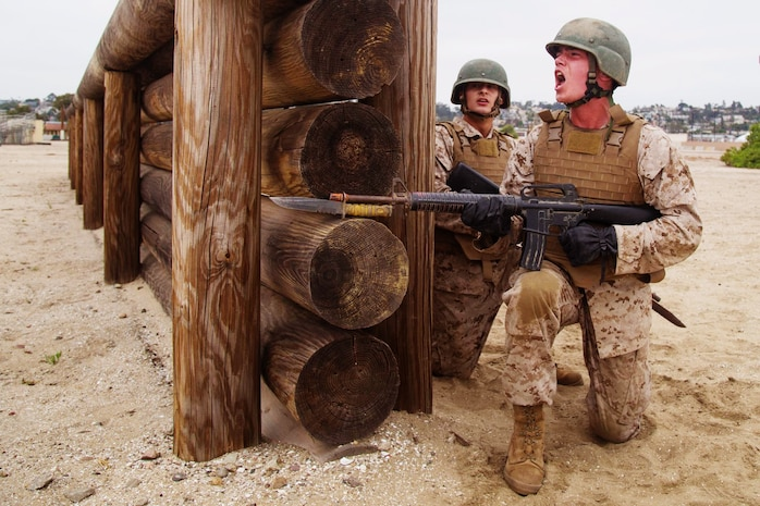 Recruits with India Company, 3rd Recruit Training Battalion participate in the Bayonet Assault course at Marine Corps Recruit Depot San Diego, June 30, 2020.