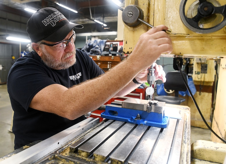 Gregg Adams, an inside machinist, locates the position of a hole in a 3D printed part of a test model so he can determine if it needs to be re-bored May 5 in the Model & Machine Shop at Arnold Air Force Base. (U.S. Air Force photo by Jill Pickett)