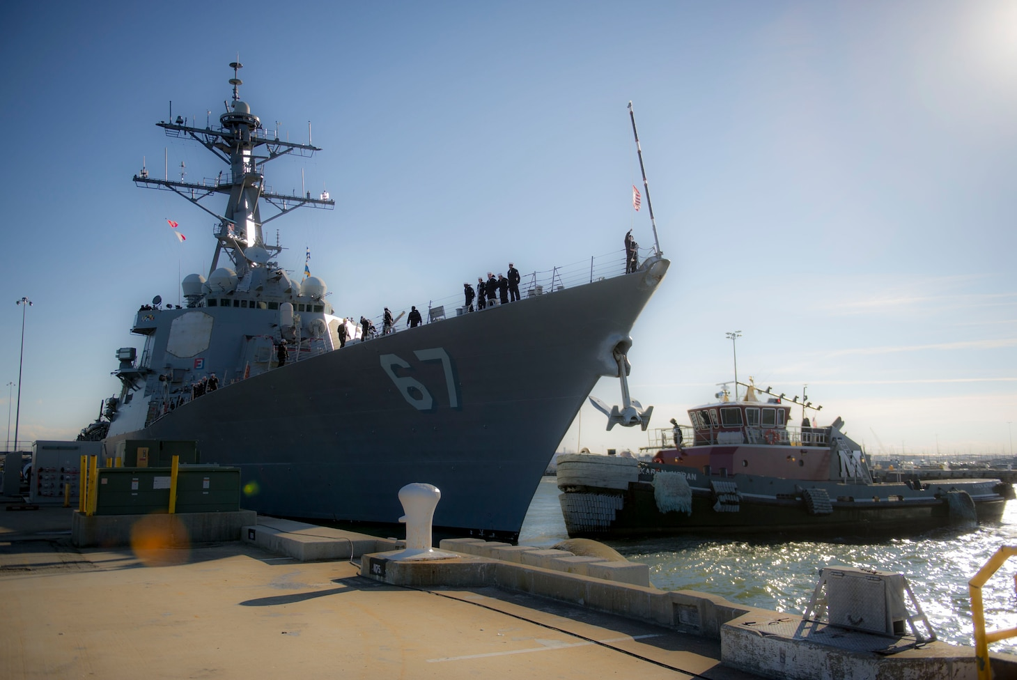 Sailors assigned to Arleigh Burke-class, guided-missile destroyer USS Cole (DDG 67) prepare to depart Naval Station Norfolk.