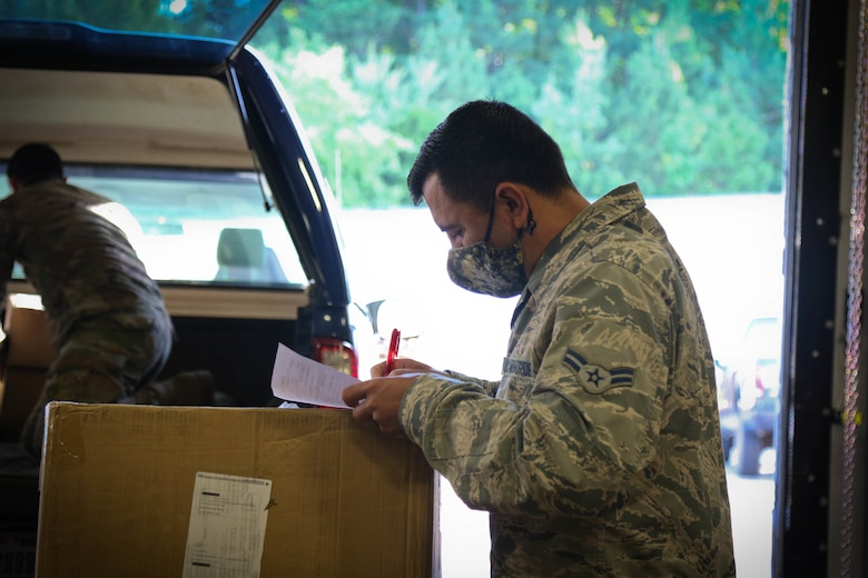 North Carolina Air National Guard Airman 1st Class Ricardo Soto, assigned to the 145th Logistics Readiness Squadron, reviews incoming medical supply orders for distribution to public and charter schools in surrounding counties at a warehouse in Central N.C., June 29, 2020. The NCNG is working with North Carolina Emergency Management, N.C. Department of Health and Human Services and local food banks to help support COVID-19 relief efforts. (U.S. Army National Guard photo by Spc. Hannah Tarkelly, 382nd Public Affairs Detachment/Released).